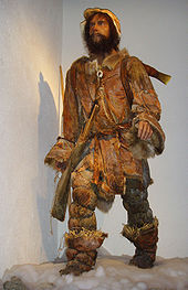 Life-size standing and fully outfitted statue of Ötzi