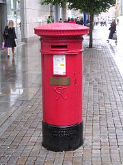 Standard UK pillar box with memorial brass plaque