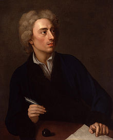 An interior scene of a man of indeterminate age in front of a non-descript grey wall. He wears a shortish grey wig, a black jacket over a white shirt, hold a pen in his right hand, and looks askance to his left (the viewer's right). A paper lies on a desk under his left hand, with an inkwell to his right (the viewers left).