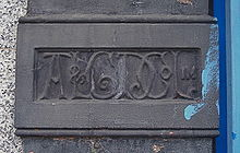 Artizans, Labourers and General Dwellings Company (Artizans Company) emblem, High Road, London N22