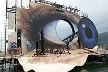A construction site where a large panel of an eye is being built.