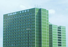 Multi-storey rectangular building with outlined windows; top floor is labeled 'EVA Air'.