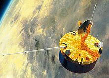 A stubby barrel-shaped spacecraft is depicted in orbit above Venus. A small dish antenna is located at the centre of one of its end faces